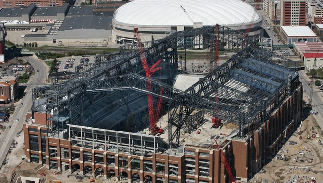Lucas Oil Stadium construction is shown, looking north toward Downtown Indianapolis, on Sept. 12, 2007. At top center is the RCA Dome, where the Indianapolis Colts used to play.