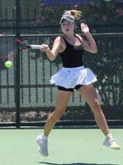 San Antonio's Fiona Crawley return a shot to Austin's