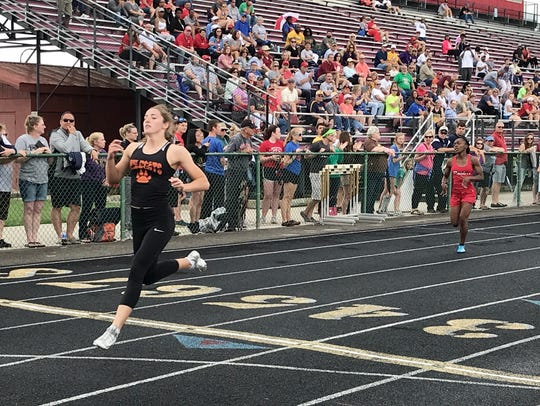 North Union's Abby Davis runs to an easy win in the