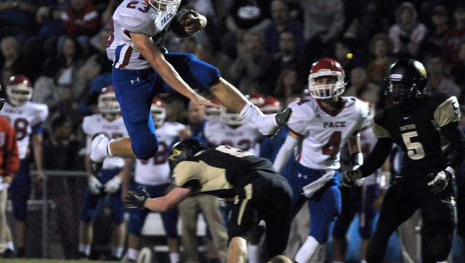 The Milton-Pace football rivalry has featured plays like this one when Pace's former star Quaide Weimerskirch leaped over a defender. The two teams play again Friday night at Pace.