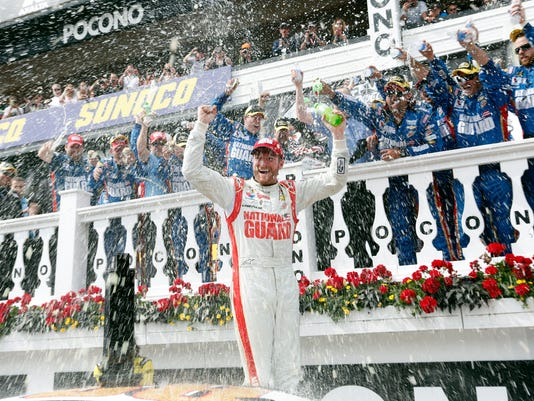 Dale Earnhardt Jr. celebrates after winning the NASCAR Sprint Cup Series Pocono 400 auto race at Pocono Raceway on Sunday, June 8, 2014, in Long Pond, Pa. (AP Photo/Mike Groll)