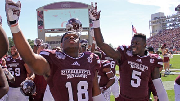 Fred Brown (5) celebrates with his team after Mississippi State's win against Texas A&M.