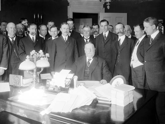 President William Howard Taft (seated) signed the Arizona