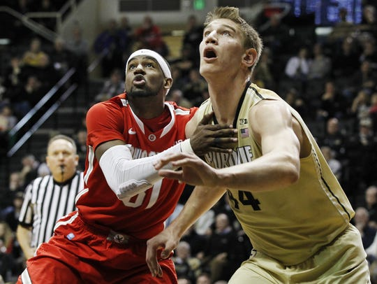 Isaac Haas and Anthony Lee of Ohio State fight for