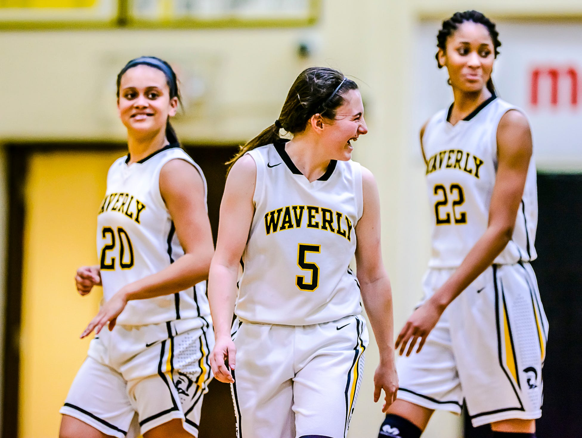 Jazlynn Wilcox, from left, Sarah Miller and Alisia Smith of Waverly celebrate after their come from behind win over Grand Ledge Tuesday February 9, 2016 in Delta Township. KEVIN W. FOWLER PHOTO