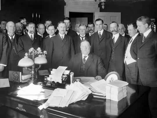 President William Howard Taft (seated) signs the Arizona Statehood Bill in Washington, D.C., on the morning of Feb. 14, 1912.
