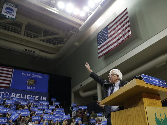 Democratic presidential candidate Bernie Sanders waves to the crowd before speaking during his campaign stop Friday at the Kress Events Center at UWGB.