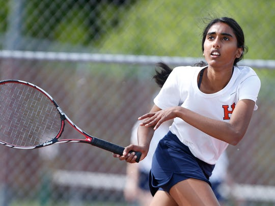 Teja Kakani of Harrison watches her return against Abney Trout of Lafayette at No. 2 singles in the first round of the girls tennis sectional Wednesday, May 18, 2016, at Cumberland Elementary School courts. Harrison sweep Lafayette Jeff 5-0.