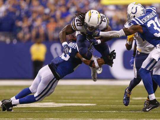 Indianapolis Colts strong safety Clayton Geathers (26) stops San Diego Chargers running back Melvin Gordon (28) midair late in the fourth quarter at Lucas Oil Stadium on Sept. 25, 2016.