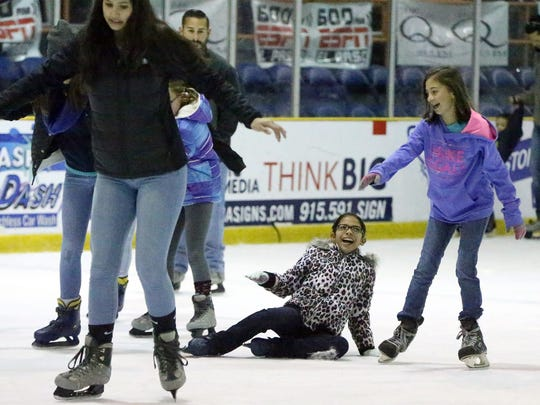 A young girl takes a spill on the Ice.