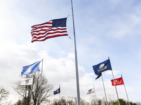 Lebanon County was under a wind advisory from 11 p.m. Sunday through 5 p.m. Monday has high winds brought down trees and power lines. Here the United States Flags, POW/MIA flag and military branch flags fly in the wind at Indiantown Gap National Cemetery on Monday, Feb. 13, 2017.