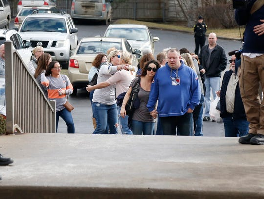 Emotional family and friends of Kelley Stage Clayton