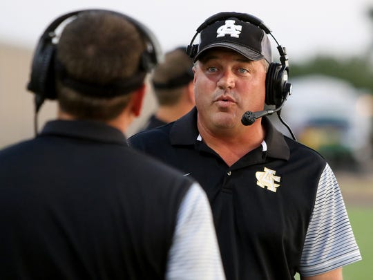 Archer City head coach Shad Hanna talks to one of his coaches during their game against Seymour Friday, Sept. 15, 2017, in Seymour at Fair Park Stadium.