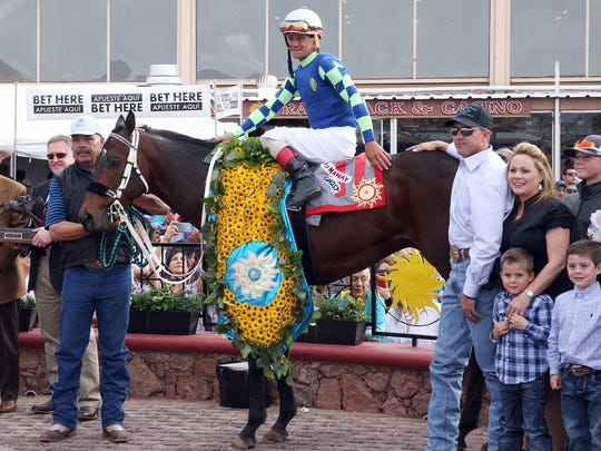 Jockey Tracy J. Hebert atop Runaway Ghost in the winners circle after the 15th running of the Sunland Derby Sunday. Trainer Todd Fincher is a right.