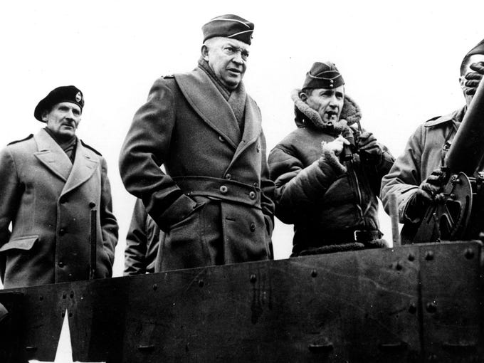 WHEN IKE PREPARED FOR D-DAY - Gen. Dwight D. Eisenhower is shown in March, 1944 when as Commander of invasion of Europe. Standing beside Ike was British air Chief Marshal Sir Arthur W. Tedder. In left background was british field marshal Montgomery. (AP-Photo)