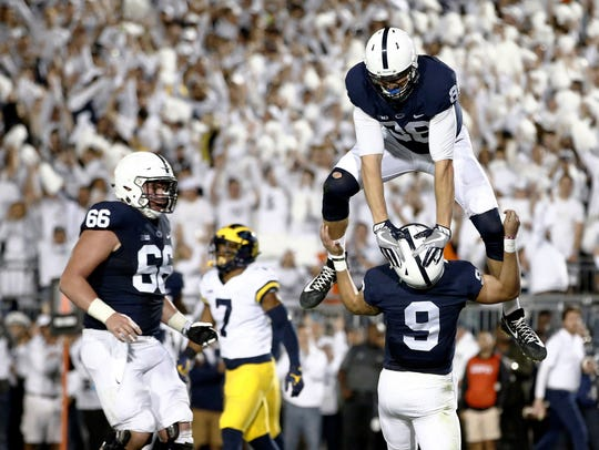 Penn State quarterback Trace McSorley, seen here celebrating with Mike Gesicki after a touchdown, hopes to lift PSU to new heights during his final season as the team's starter. AP FILE PHOTO
