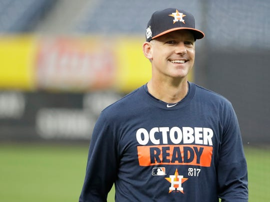 Houston Astros coach AJ Hinch smiled during the training session at Yankee Stadium for Match 3 of the American League Championship Series baseball match against the New York Yankees Sunday, October 15, 2017, in New York.  (Photo AP / David J. Phillip)
