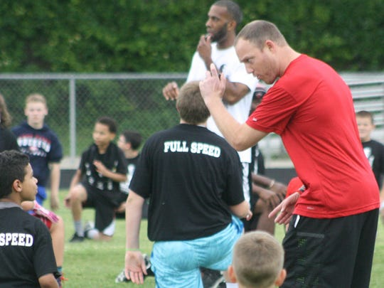 Tim Shaw shares some pointers to a young camper Friday night.