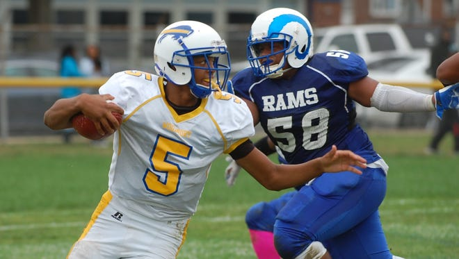 Freshman quarterback Andre  Parker has make a significant impact for the Woodbury High School football team in his first season. He helped the Herd rally last week to beat Penns Grove in overtime.
