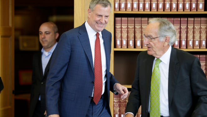 New York City Mayor Bill de Blasio walks with former Iowa Sen. Tom Harkin, right, before speaking about income inequality during a visit to Drake University on  Thursday, April 16, 2015, in Des Moines.