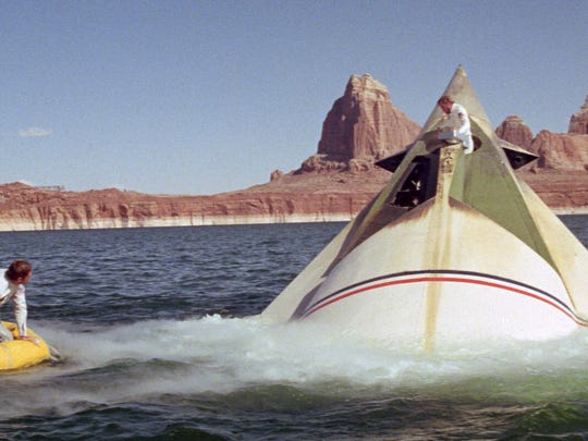 "Lake Powell near Page was an otherworldly stand-in for this scene from ""The Planet of the Apes."" The 1968 sci-fi thriller starred Jeff Burton (from left), Robert Gunner and Charlton Heston (climbing out of the ship)."