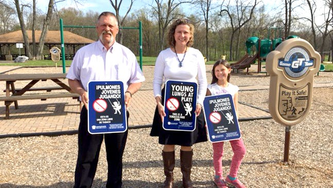 Pictured holding Young Lungs at Play signs at H.M. Levitz Memorial Park in East Hanover Township are, from left, Ross Henderson, H.M. Levitz Memorial Park; Holly Dolan, Lebanon Family Health Services; and Abigail Dolan.