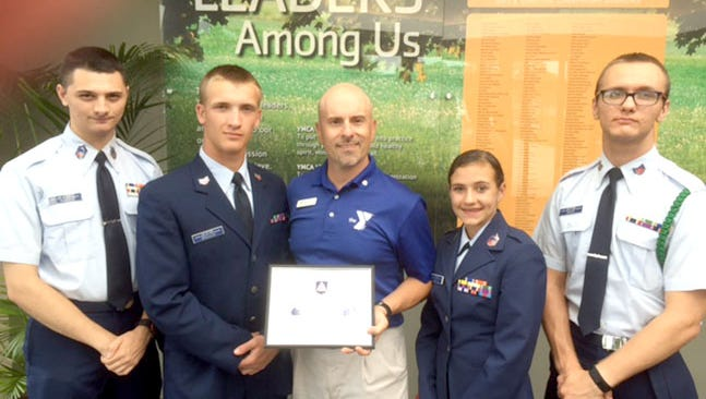 Darin Pickles, center, director of operations for the Lebanon YMCA, receives a certificate of appreciation recently for partnering with U.S. Air Force Auxillary, Civil Air Patrol, Squadron 307 and coordinating winter training sessions indoors. Also pictured are, from left, Cadet Chief Master Sgt. Ryan Mantz; Cadet Staff Sgt. Blaise Bressler; Cadet Chief Master Sgt. Brook Lynn Bartal; and Cadet Tech. Sgt. Dylan Moyer.