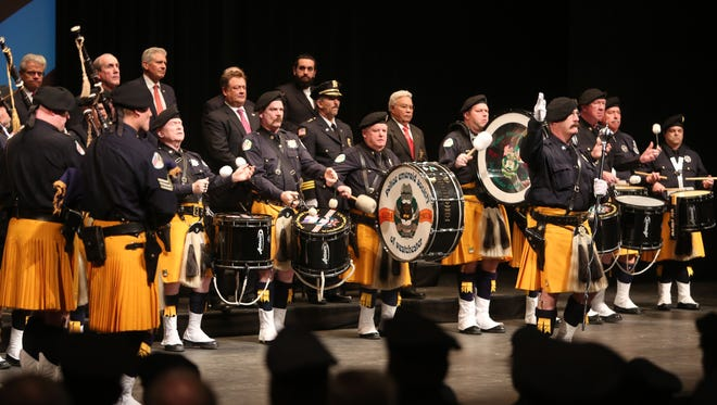 Westchester police chaplain Jeremy Reichberg, top center, attends the 140th Westchester County Police Academy graduation at Purchase College on Dec. 18.