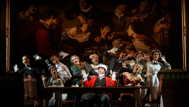 """Performers from the National Touring Company of """"A Gentleman's Guide to Love & Murder,"""" which opens at the Aronoff Center Jan. 3 as part of the Broadway in Cincinnati series. The cast include John Rapson as Lord Adalbert D'Ysquith (front row, center, in red) and Kristen Mengelkoch as Lady Eugenia, third from L in the second row, in the green gown."""