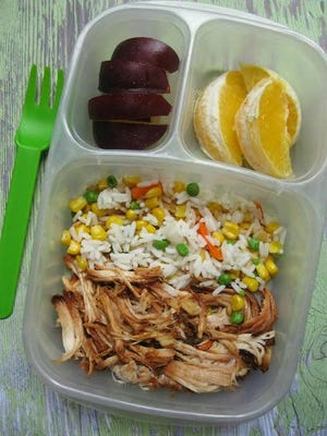 Leftover chicken is dressed up with barbecue sauce, rice and frozen mixed veggies.