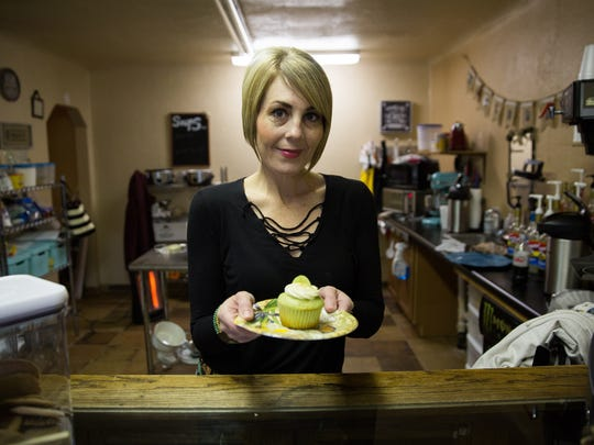 Candace Butler, owner and baker at Butler Baking Co., holds a key lime cupcake, Friday, December 30, 2016