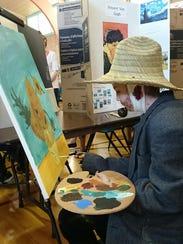 Elyssa Hancock, aka Vincent Van Gogh, holds a painterly