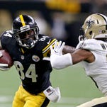 Steelers wide receiver Antonio Brown tries to fight past Saints cornerback P.J. Williams Friday night during the first quarter in New Orleans.