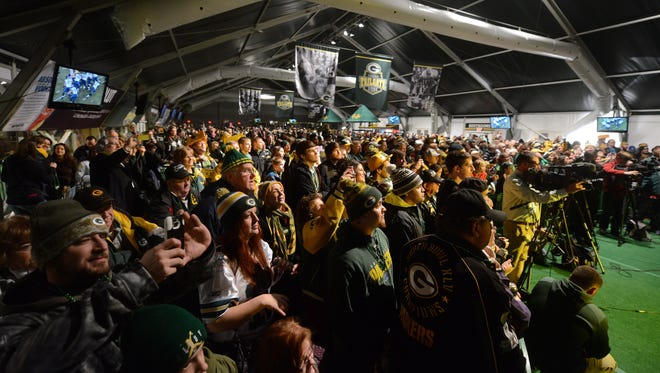 Fans pack into Lambeau Field's Tundra Tailgate Zone for an NFC Championship Game pep rally in Green Bay, Wis. on Thursday, Jan. 15, 2015. Kyle Bursaw/Press-Gazette Media/@kbursaw