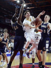 Irondequoit's Zach Stenglein, center, splits the defense of Lourdes' James Anozie, left, and Aidan Hildebrand during the NYSPHSAA Boys Basketball Championships Class A final in Binghamton on March 19, 2017.