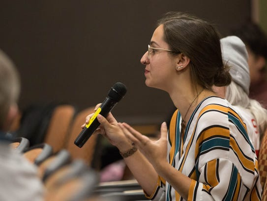 Amy Yurwit, a student at New Mexico State University, asks about the balance between keeping statues as a talking point or removing them during the SPACE NMSU Panel discussion at the NMSU Health College Auditorium on Tuesday, November 14, 2017.