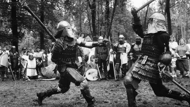 NONE SHALL PASS: Members of the Society for Creative Anachronism recreate medieval tournament fighting during the Renaissance Fair at Old Indiana Fun Park near Thorntown in 1989.