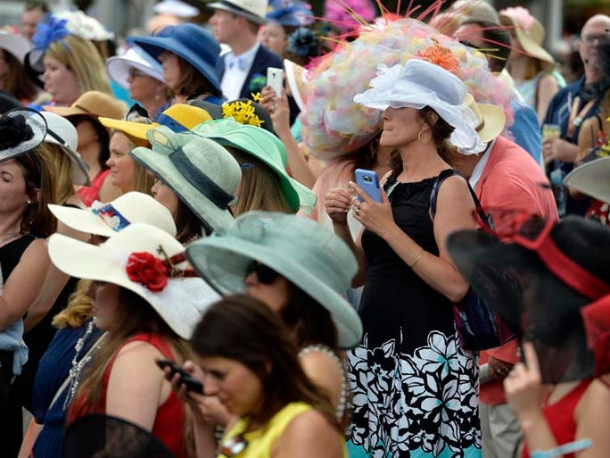 May 7, 2016; Louisville, KY, USA; Fans in derby hats take photos as celebrities arrive on the red carpet before the 142nd running of the Kentucky Derby at Churchill Downs. Mandatory Credit: Jamie Rhodes-USA TODAY Sports