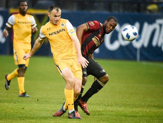 Nashville SC defender Liam Doyle (5) and Atlanta United