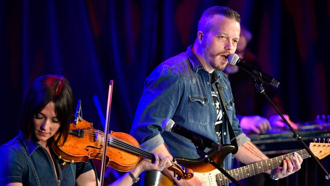"Jason Isbell performs ""Pancho and Lefty"" at the CMHOF's ""Outlaws and Armadillos"" opening concert. Friday May 25, 2018, in Nashville, Tenn."