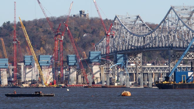 The main support towers for the new Tappan Zee Bridge rise near the current win span Nov. 20, 2015.