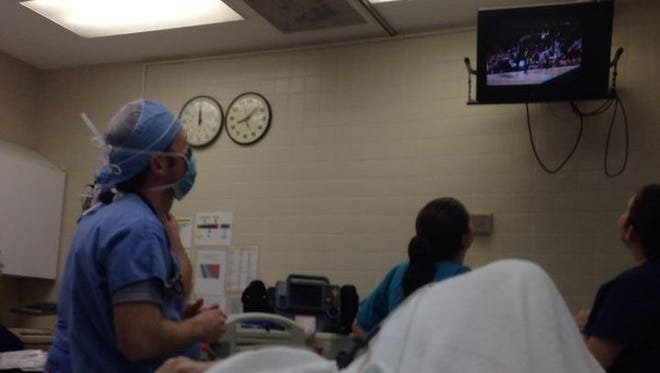 This 81-year-old woman in the ER wouldn't let doctors begin fixing her collapsed lung until Memphis game ended.