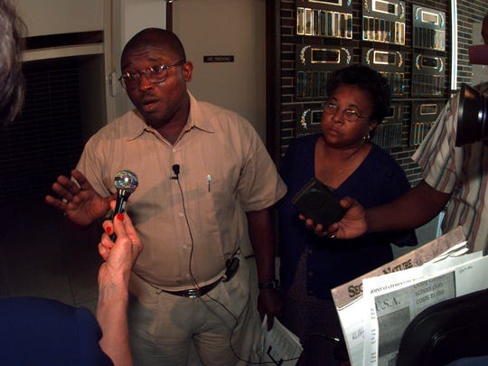 In this 1999 file photo, Rapides Parish School Board members Herbert Dixon and Rodessa Metoyer are shown talking to reporters after walking out of the meeting following a vote to hire new desegregation attorneys.