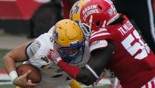 UL defensive end Trev Miller tackles McNeese State's Khalil Thomas in the first quarter at Cajun Field on Saturday.