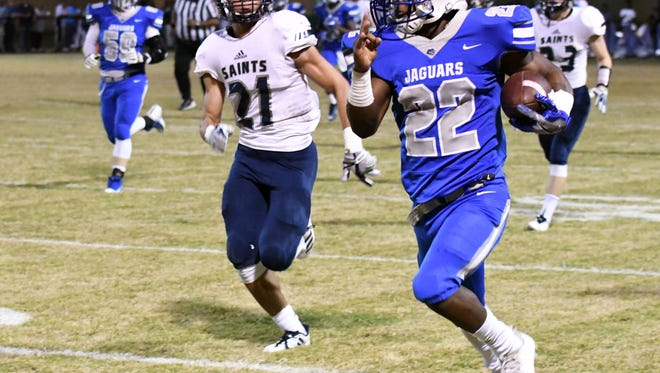 Jefferson Davis County running back Jafharis McKines carries the ball for a touchdown in their first playoff game against St. Andrew's in Bassfield on Friday.