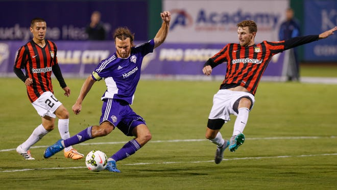 Louisville City FC's Matt Fondy takes a shot on goal in the first half of Saturday's playoff victory over Charleston.  Oct. 3, 2015