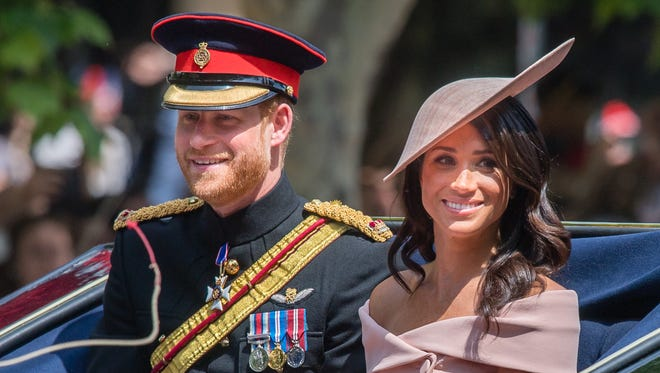 Prince Harry and Meghan, Duchess of Sussex, ride by carriage during Trooping The Colour 2018 on the Mall on June 9 in London.