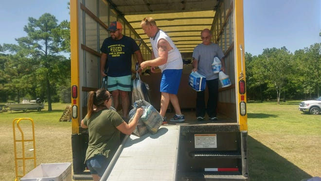 Scott Julius helps load a truck to go to Texas.