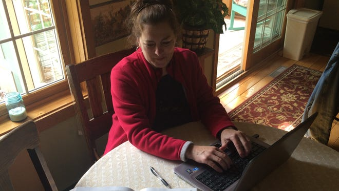 Donna Larsen of Amherst said her struggle to stay connected to the Internet hinders her ability to finish her school work as she studies to become a nurse.