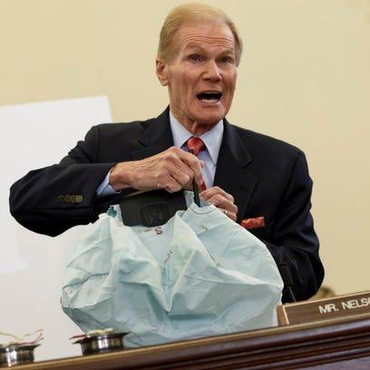 Sen. Bill Nelson, D-Fla., shows a bad air bag at a